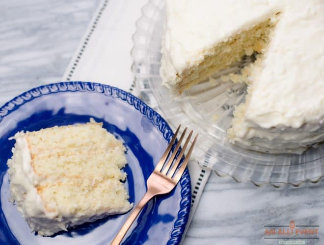 One Slice of Coconut Cake and a whole coconut cake side by side