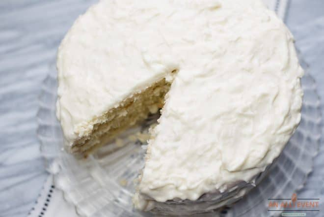 Best Coconut Cake With Frosting on a glass cake plate