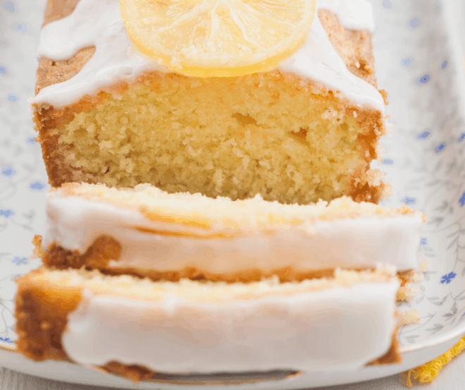 Lemon Bread with Lemon Glaze sliced on a serving tray