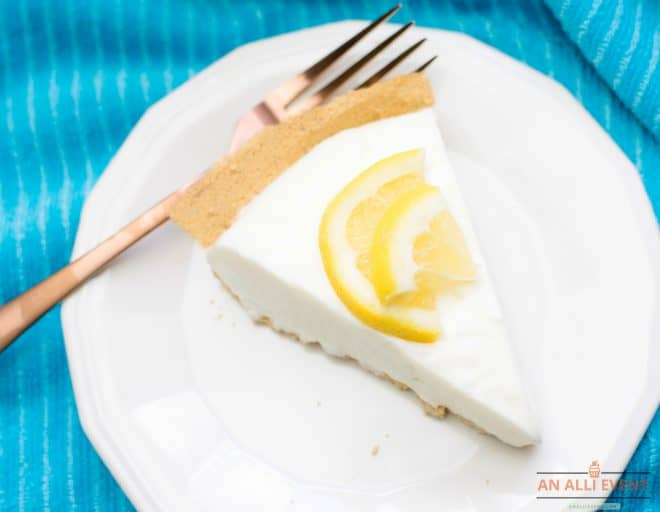 Slice of Lemon Icebox Pie on White Plate on a Blue Cloth