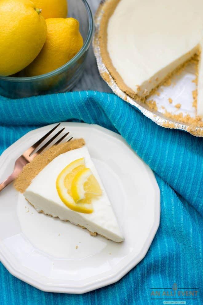 Lemon Pie on a blue cloth and a bowl of lemons