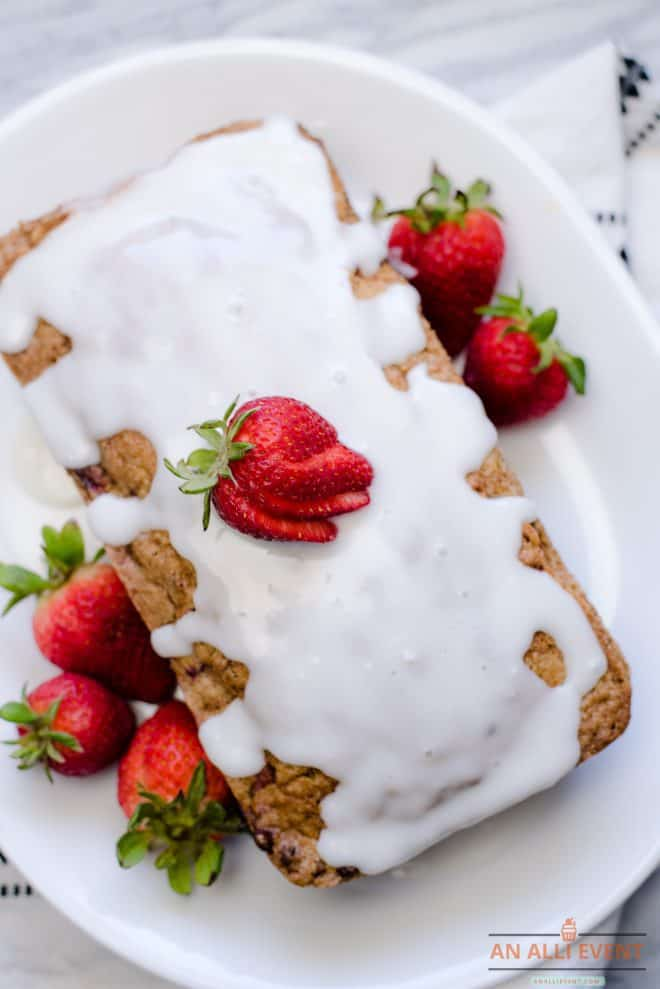 Unsliced Loaf of Strawberry Bread on platter
