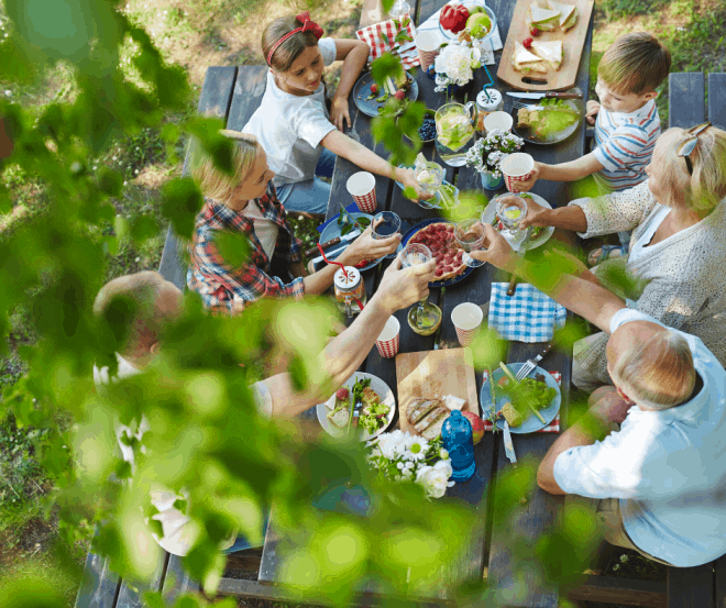 Family Eating Outside at Picnic Table
