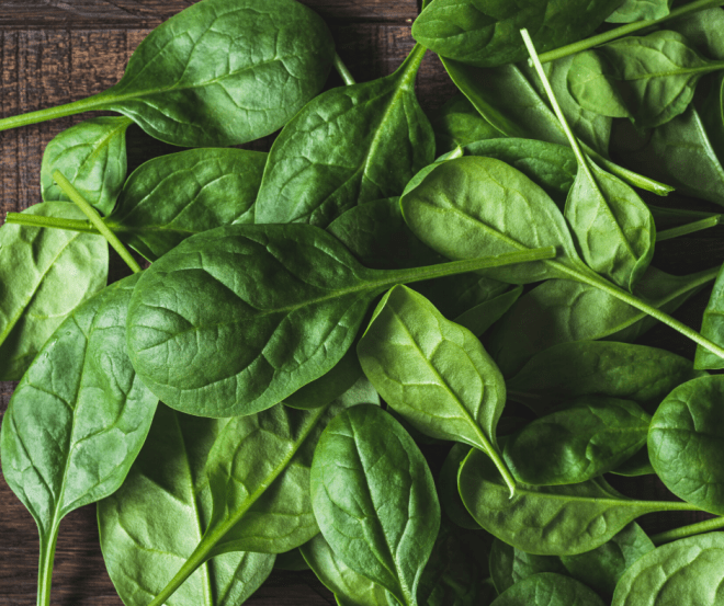 Spinach Leaves on a dark brown wooden countertop