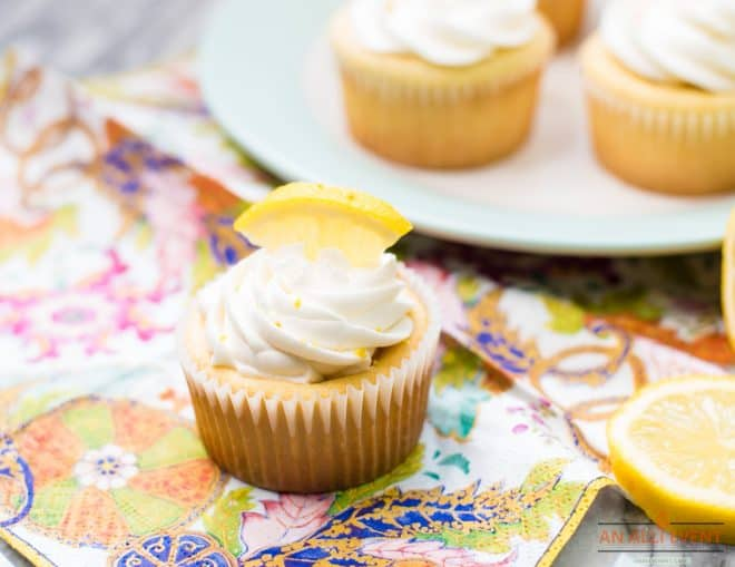 Closeup photos of cupcakes with lemon buttercream frosting and a lemon wedge on top