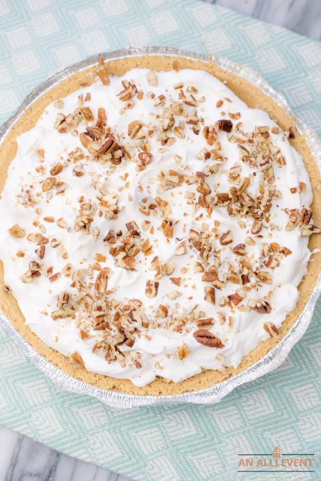 Banana Split Pie Topped With Whipped Topping and Nuts