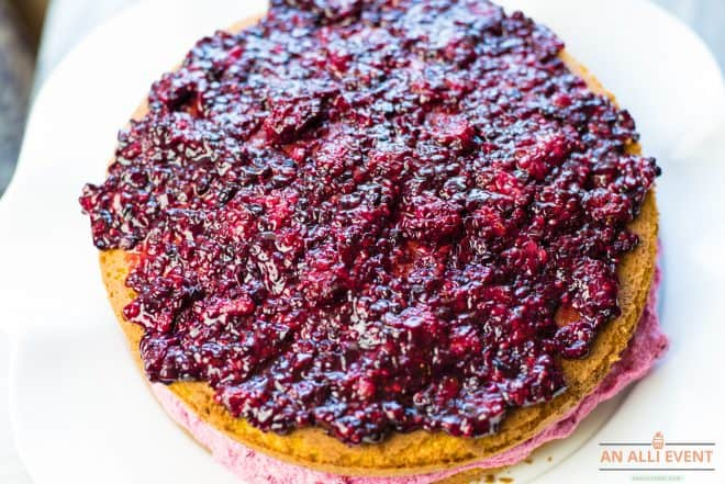 Middle Layer of Cake topped with blackberry coulis