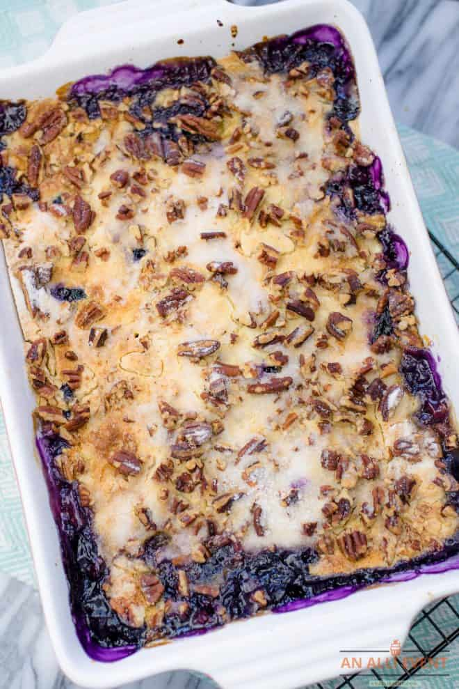Blueberry Crunch Dump Cake in white baking pan
