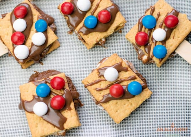 Patriotic S'Mores On A Stick on a baking pan