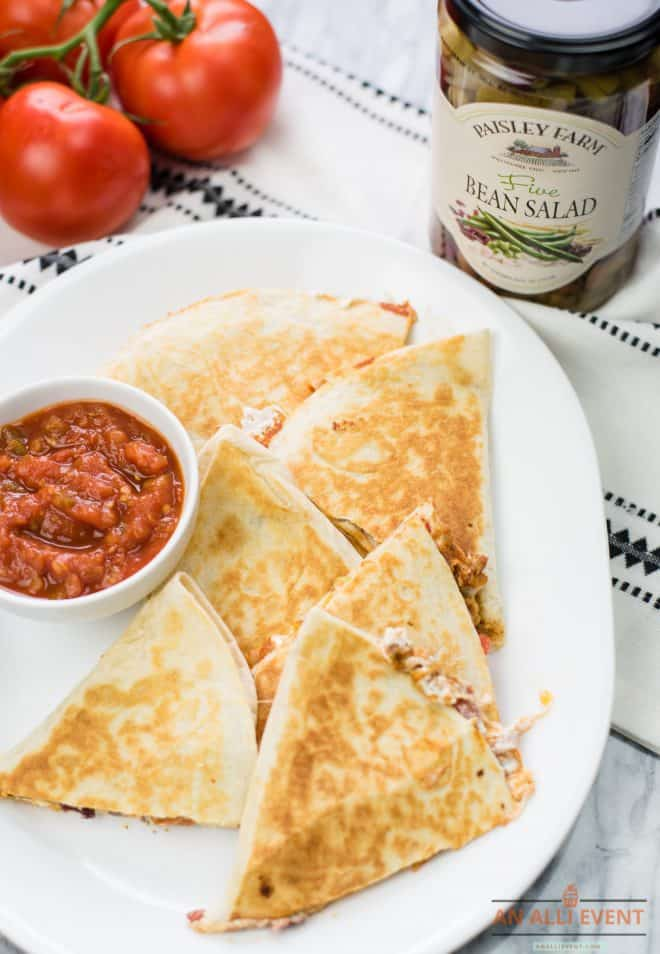 Taco Dip Quesadillas on a white plate served with tomato salsa
