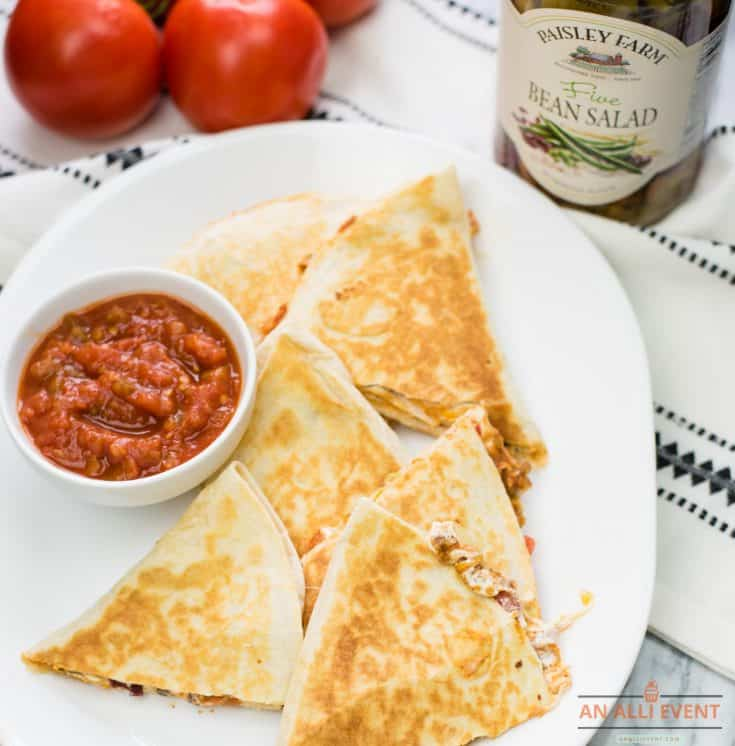 Wedges of Taco Salad Quesadillas on white serving platter