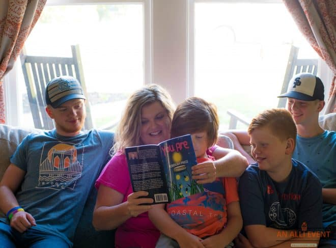 A mom, reading the book You Are, to her four children