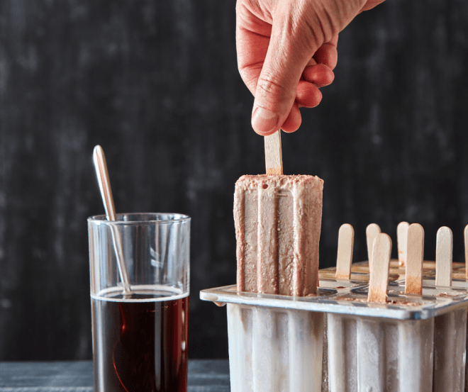 coffee infused desserts including coffee popsicles being pulled out of the mold