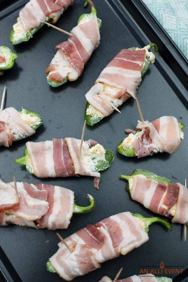 Jalapeno Poppers Wrapped With Bacon on Baking Dish