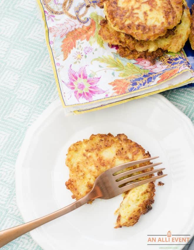 Squash Patties on white plate with gold fork