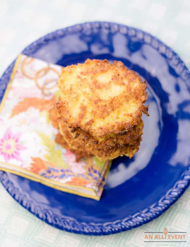 Squash patties stacked on a navy blue plate