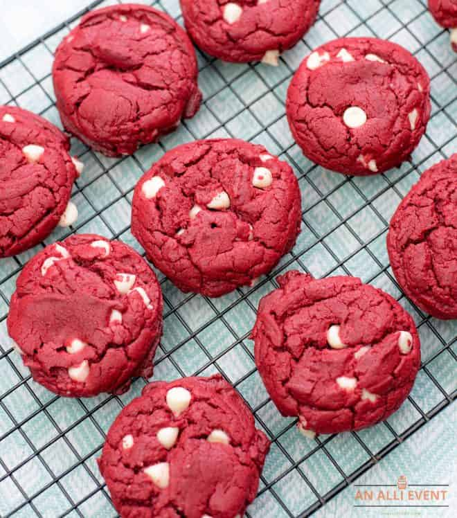Cake Mix Red Velvet Cookies on a black wire rack