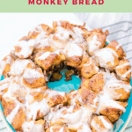 Spiced Apple Monkey Bread on rack and drizzled with white icing