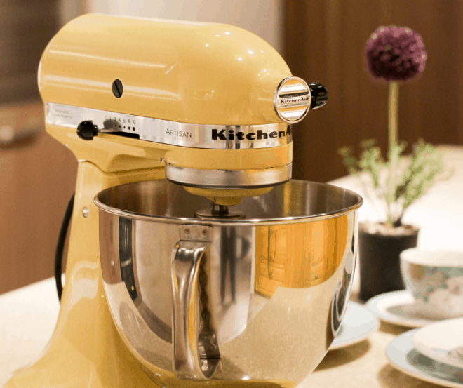Yellow KitchenAid Stand Mixer with silver bowl on counter
