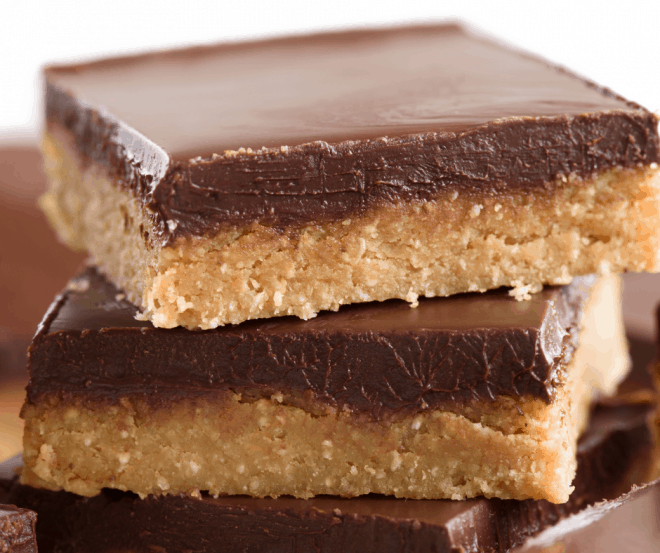 Closeup Photo of Chocolate Peanut Butter Squares stacked on top of each other