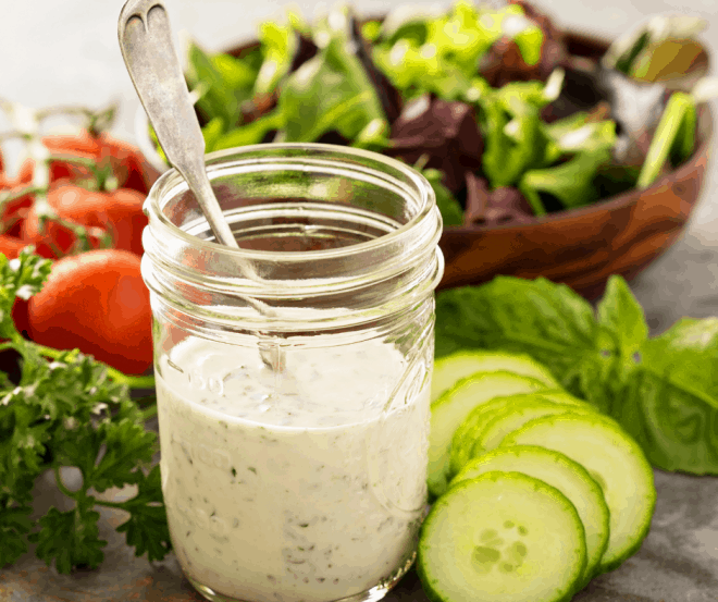 Ranch Dressing in glass jar and green salad