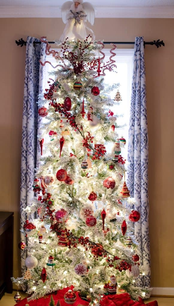 Slim Flocked Christmas Tree With Red And White Ornaments An Alli Event