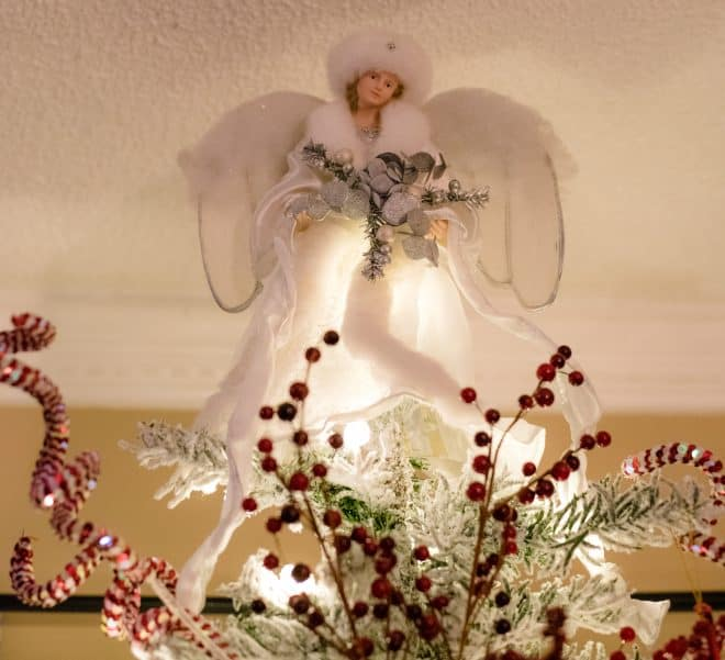 White Snow Angel on Top Of Flocked Christmas Tree