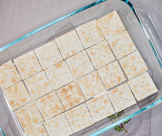 Saltine Crackers lining a 13x9 glass baking dish