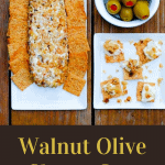 Walnut Olive Cheese Log with olives in a white bolw