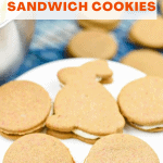 Carrot Cake Sandwich Cookies on a white cake stand with more cookies in the background