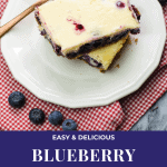 Blueberry Cheesecake Bars stacked on a small white plate