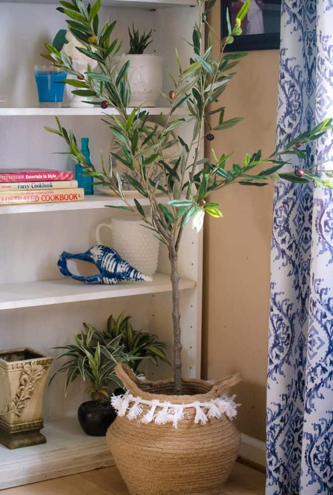 favorite faux olive tree in a boho brown woven basket with tassels