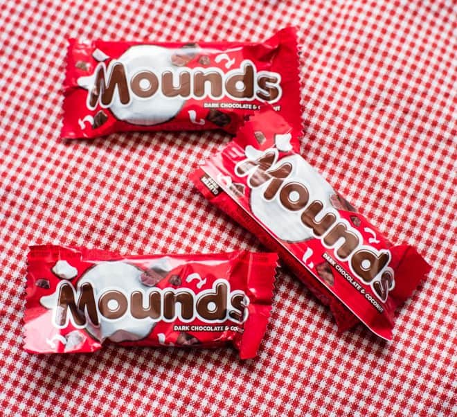 three snack size Mounds candy bars on a red and white cloth