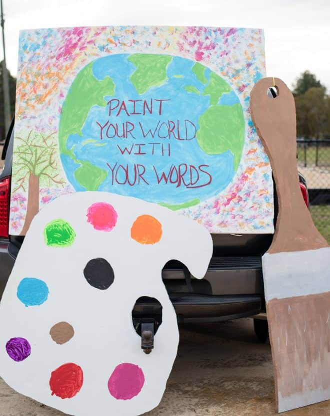 Bob Ross Closeup of Trunk with Paint Your World With Your Words Sign and a DIY life-size paint brush