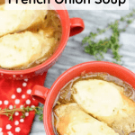 Bowls of French Onion Soup topped with sliced bread and cheese