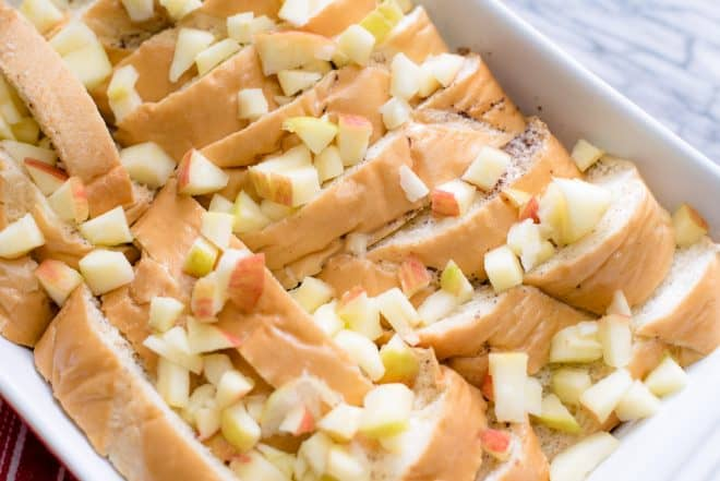 a chopped apple spooned over french bread for apple baked french toast