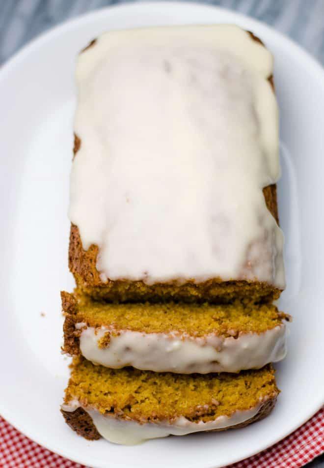 sweet potato bread with a vanilla glaze on a white platter